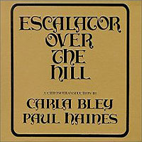 Обложка альбома «Carla Bley. Paul Haines. Escalator Over The Hill» (Paul Haines, Carla Bley, 2006)